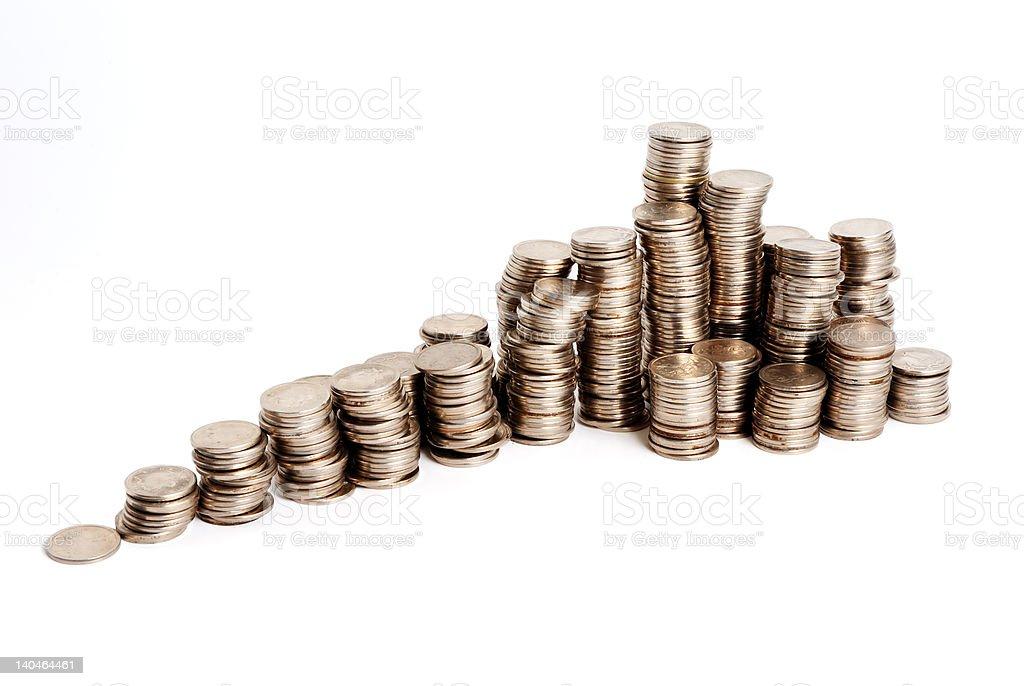 Increasing pyramid of small coins royalty-free stock photo