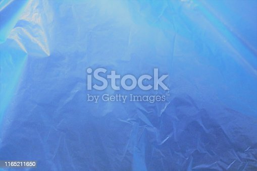 istock Incredible beautiful  fantastic unreal cosmic fieric scientific blue cellophane matte brilliant shining shimmering celestial organic bright gentle soft delicate gradient - blue background 1165211650