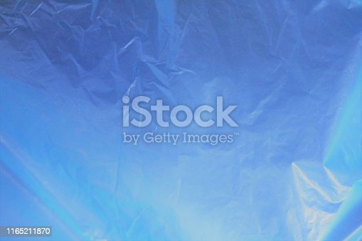 istock Incredible beautiful  fantastic unreal cosmic fieric scientific blue cellophane matte brilliant shining shimmering celestial organic bright gentle soft delicate gradient - blue background 1165211870