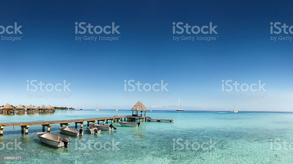 Incredible Blue Sky Above Pier in Rangiroa, French Polynesia stock photo