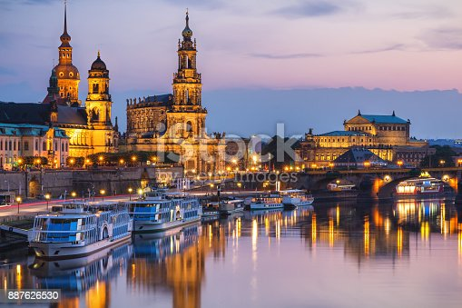istock Incredible evening panorama of Cathedral of the Holy Trinity or Hofkirche, Bruehl's Terrace or The Balcony of Europe. Dramatic autumn sunset on Elbe river in Dresden, Saxony, Germany, Europe. 887626530