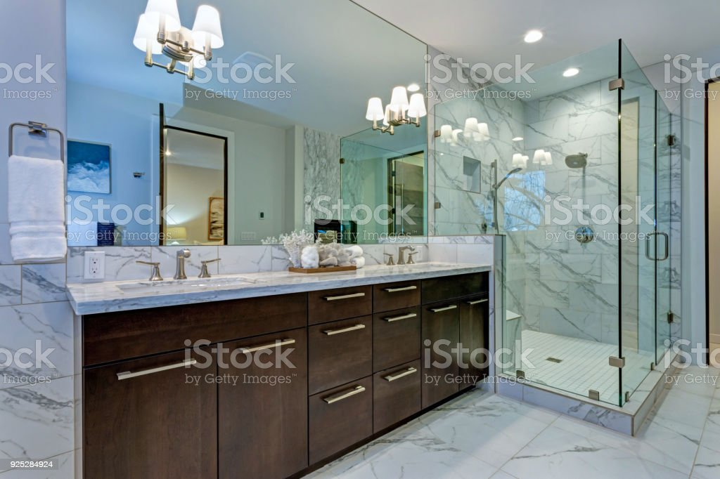Incredible Master Bathroom With Carrara Marble Tile Surround Stock