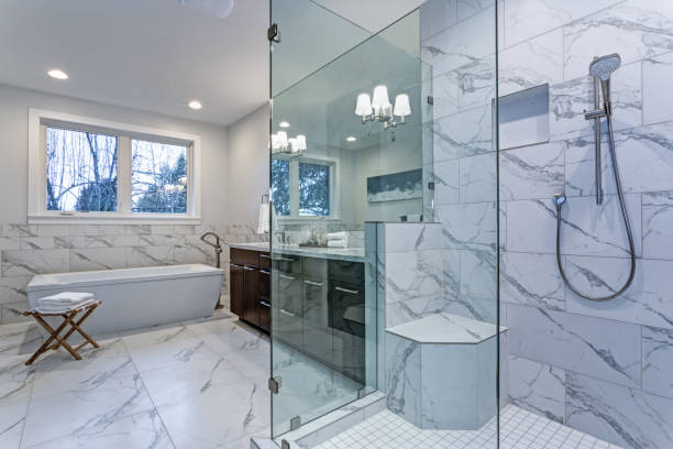 Incredible master bathroom with Carrara marble tile surround. stock photo
