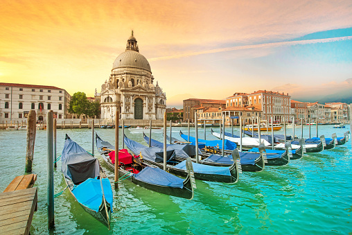 Incredible optimistic color landscape of gondolas on the Grand Canal in the background Basilica Santa Maria della Salutein at dawn in Venice, Italy, Europe. (Romantic travel, honeymoon - concept)