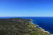 Incredible view on mediterranean sea in Akamas Peninsula National Park, Cyprus. Blue sky with green park on the north part of cyprus island. Travellers are enjoy this outlook from rock hill.