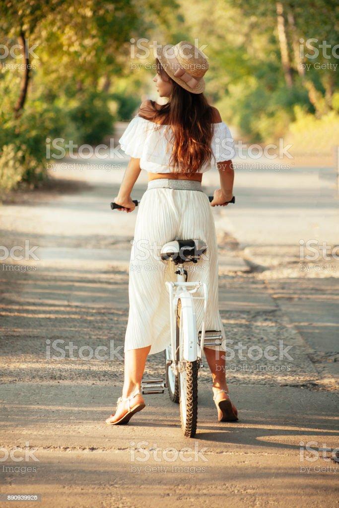Incredibly beautiful and stylish girl on a romantic bike стоковое фото