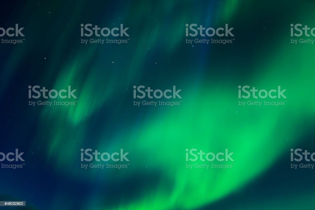 Incredibly bright Aurora borealis (Northern lights)  over the Iceland stock photo