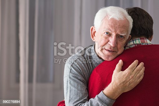 istock Incurable senior and his son 590276894