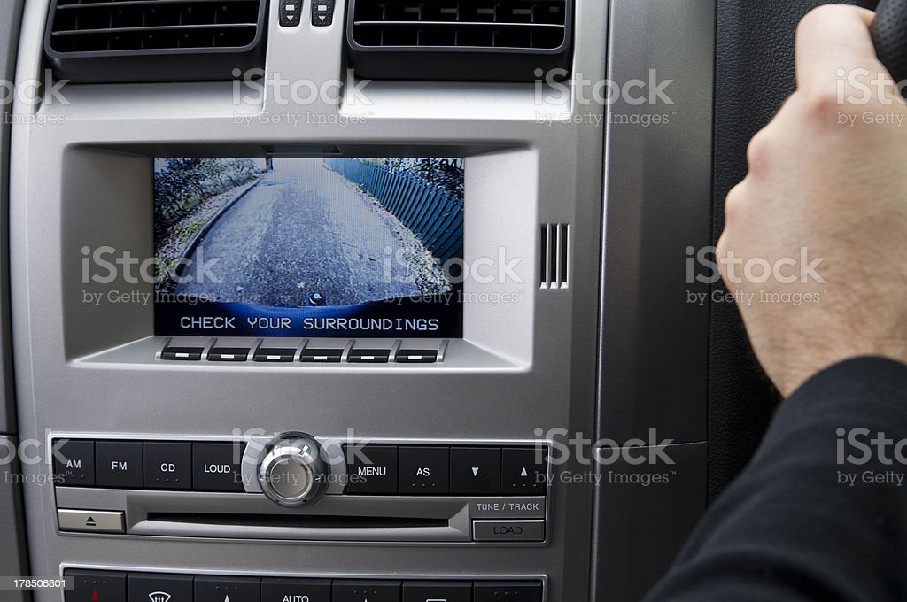 In-dash Reversing camera (RHD) A stock photo of an in dash reversing camera showing the view of a suburban driveway. Backup camera Stock Photo