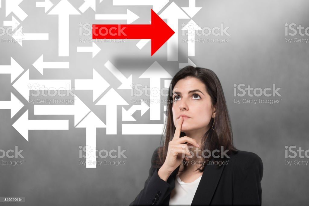 Indecision businesswoman arrows stock photo
