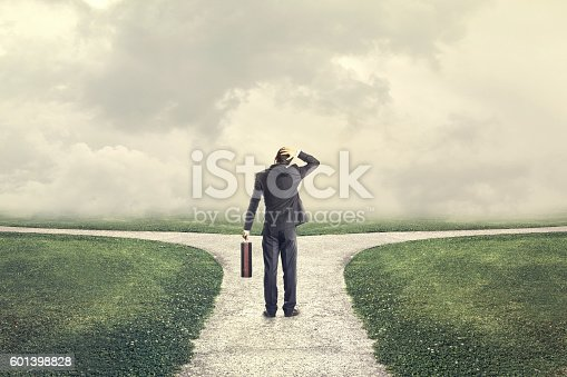 istock indecisive and lost man chooses the right path 601398828