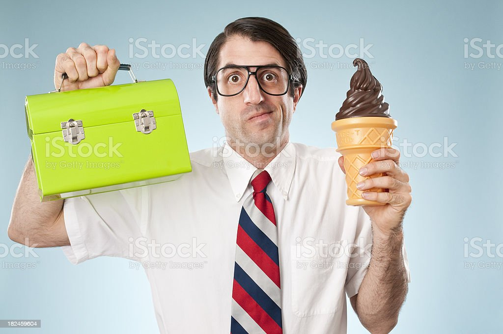 Indecisive Nerd With Ice Cream Cone And Lunch Box royalty-free stock photo