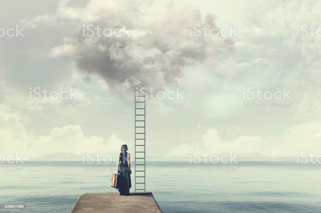 Indecisive woman does not know if climb up a ladder from the sky to a disenchanted destination stock photo