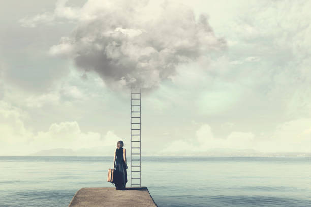 indecisive woman does not know if climb up a ladder from the sky to a disenchanted destination - enigma images stock photos and pictures