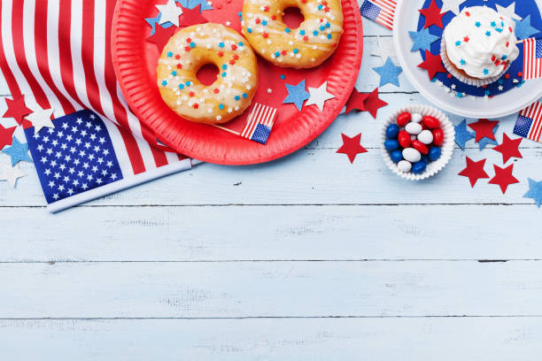 Independence Day background on 4th of July with american flag, stars and food on wooden table top view. stock photo