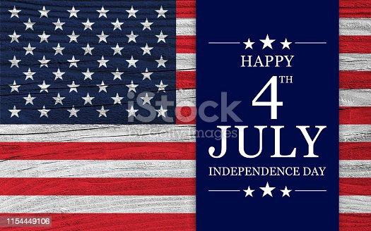 Celebrative texts for USA Independence Day on American style backdrop, with national flag elements superimposed on wooden surface.