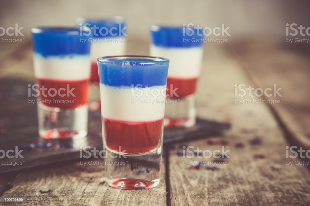 Independence day concept - flag coloured short cocktails on rustic background stock photo