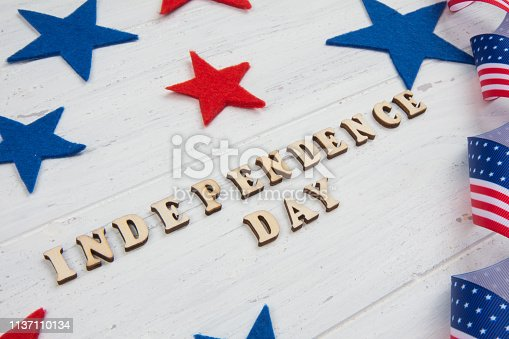 istock Independence Day. Happy Fourth of July. Text and USA flag 1137110134