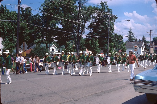 Belvidere, Illinois, USA, 1974. The citizens of Belvidere / Illinois celebrate the Independence Day with a parade. They stand along the N State St in the heart of Belvidere.