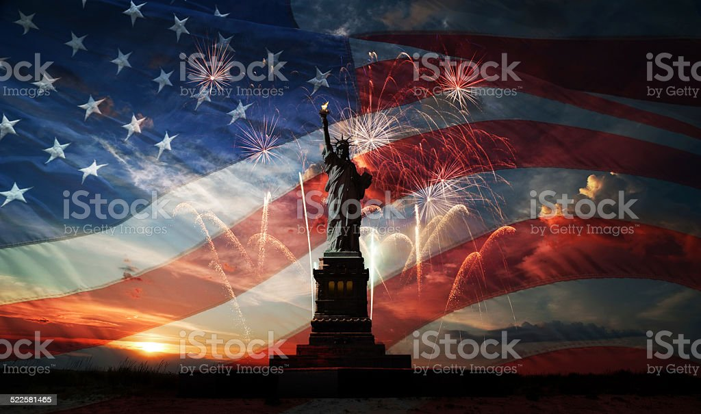 Independence day. Liberty enlightening the world Statue of Liberty on the background of flag usa, sunrise and fireworks Anniversary Stock Photo