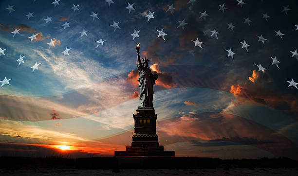 Independence day. Liberty enlightening the world Statue of Liberty on the background of flag usa and sunrise independence day photos stock pictures, royalty-free photos & images