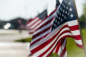 Looking into the light , American Flags all in a Row waving in the wind perfect wave