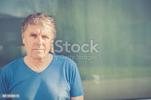 istock Independent Senior man with gray hair portrait outdoors 661808618