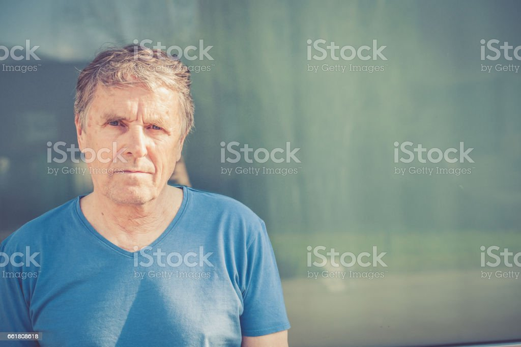 Independent Senior man with gray hair portrait outdoors stock photo