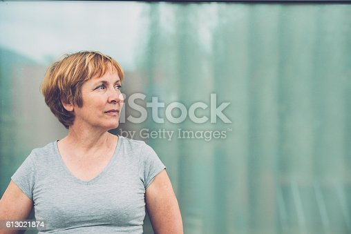 istock Independent Senior woman portrait - looking away, front view 613021874