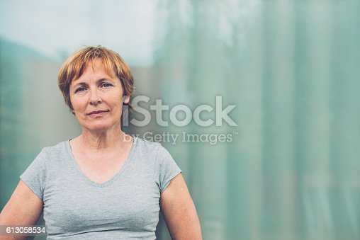 istock Independent Senior woman with short hair portrait outdoors 613058534