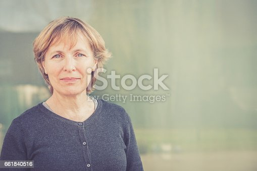 istock Independent Senior woman with short hair portrait outdoors 661840516