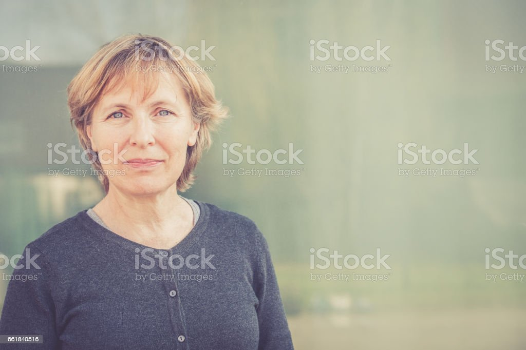 Independent Senior woman with short hair portrait outdoors - foto stock