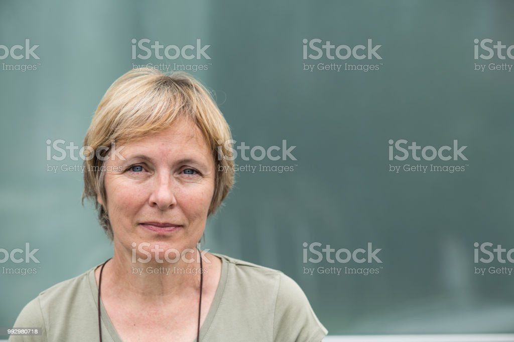 Independent Senior woman with short hair portrait outdoors royalty-free stock photo