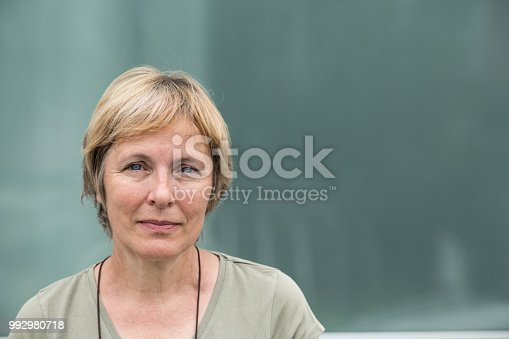 Independent Senior woman with short hair portrait outdoors , copy space, no logo. Europe, Slovenia. NIKON D850, 105.0 mm f/2.8.