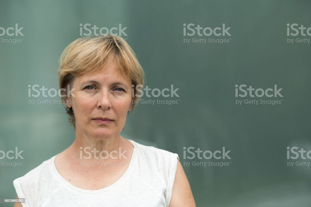 Independent Senior Woman With Short Hair Portrait Outdoors Stock