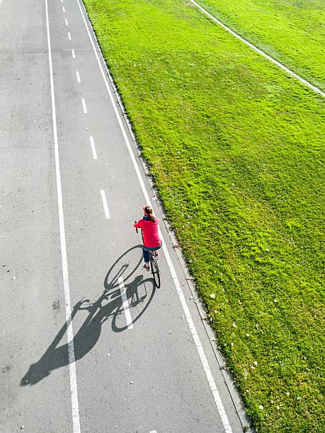 independent woman cycling - single pampas grass bildbanksfoton och bilder