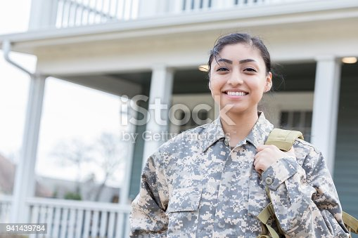 istock Independent young female soldier departs for overseas deployment 941439784