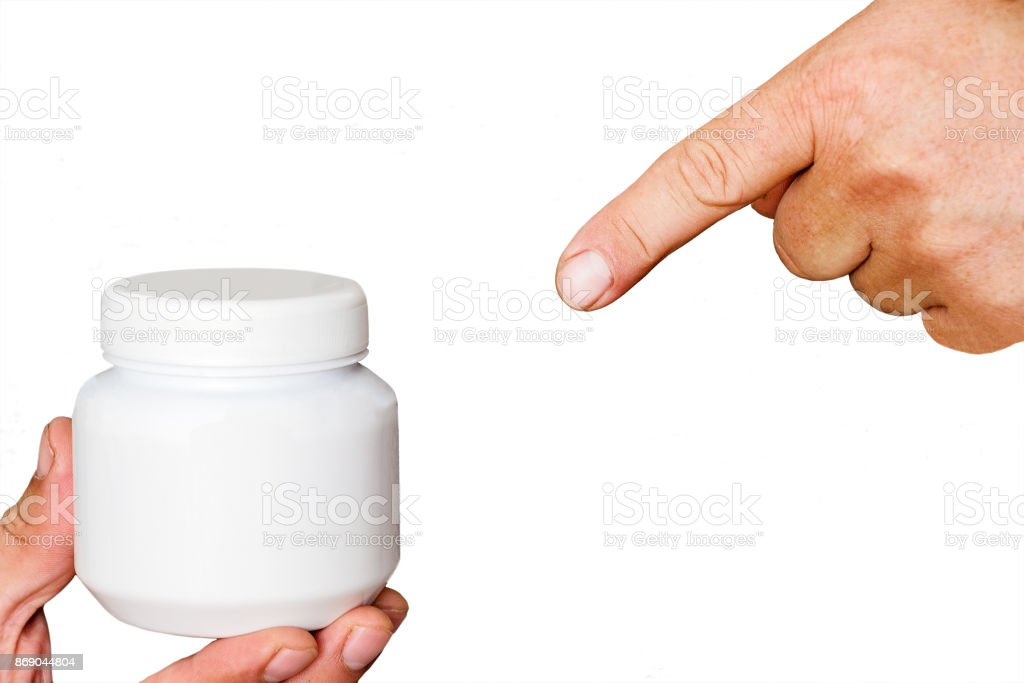 Index finger shows on Jar of cream stock photo