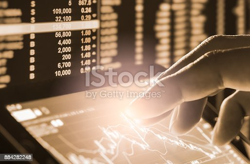 istock Index graph of stock market financial indicator analysis on LED. Abstract stock market data trade concept. Stock market financial data trade graph background. Global financial graph analysis concept. 884282248