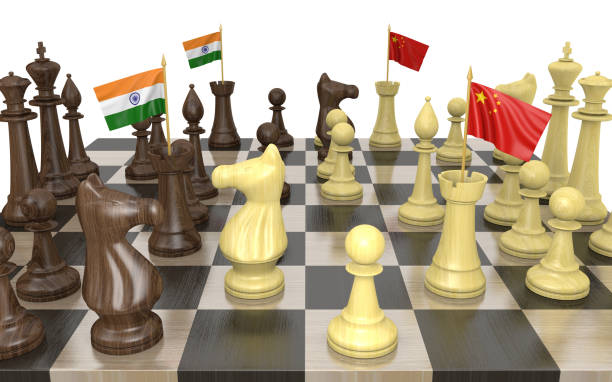 India and China foreign policy strategy and power struggle, 3D rendering India and China strategic relations and foreign policy struggles represented by a chess game rendered in 3D. foreign affairs stock pictures, royalty-free photos & images