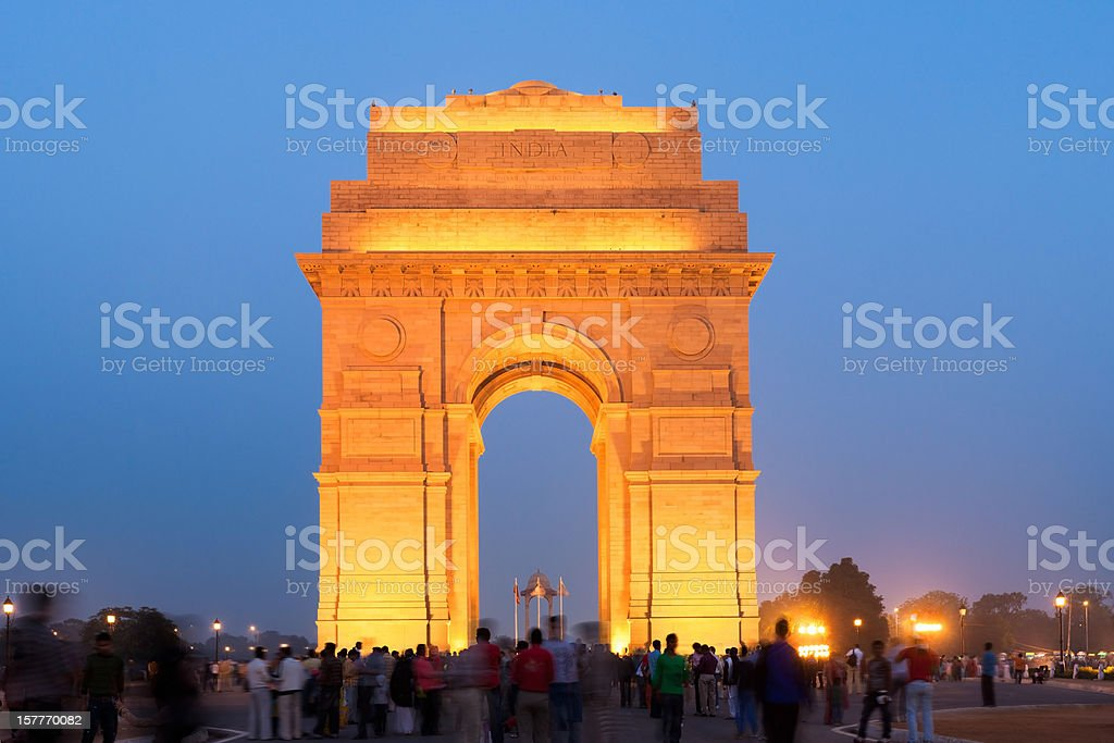 India Gate New Dehli India Gate during twilight crowded with people, motion blured unrecognizable people. Built in the memory of more than 90,000 Indian soldiers who lost their lives during the Afghan Wars and World War I, the India Gate is one of the most famous monuments in Delhi. New Delhi, India. Arch - Architectural Feature Stock Photo