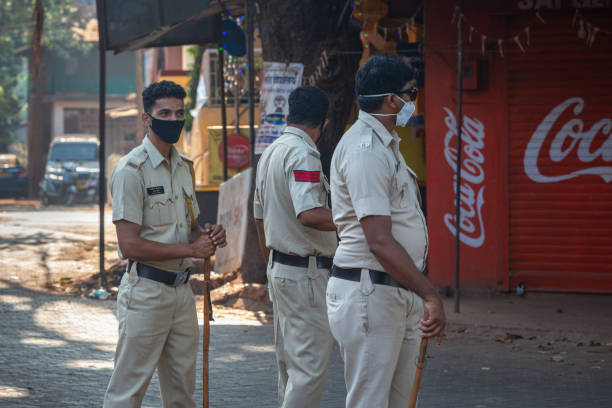 03/28/2020 India, GOA, Arambol, Police (CRPF) personnel stops and controled commuters during Indian lockdown and curfew as preventive measure against COVID-19 coronavirus stock photo