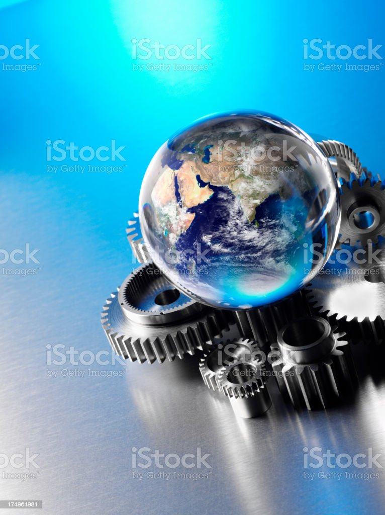 India in a crystal Globe with Metal Wheels and Cogs royalty-free stock photo