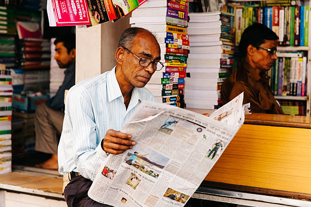 India Newspaper Reading Calcutta Stock Photos, Pictures & Royalty