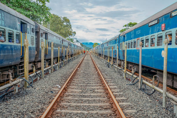 20/10/2019 India, Maharashtra prospective image of two Indian train with rail between them with gloomy sky. Train to GOA. overpopulation concept stock photo