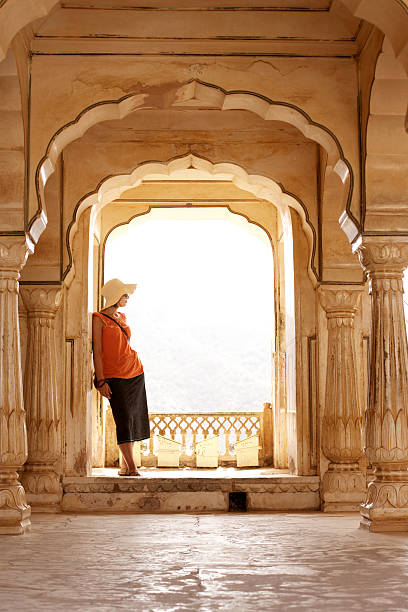 India, Rajasthan, Amber Fort, woman standing on palace balcony stock photo