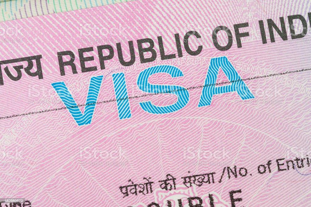 India visa in a passport macro stock photo