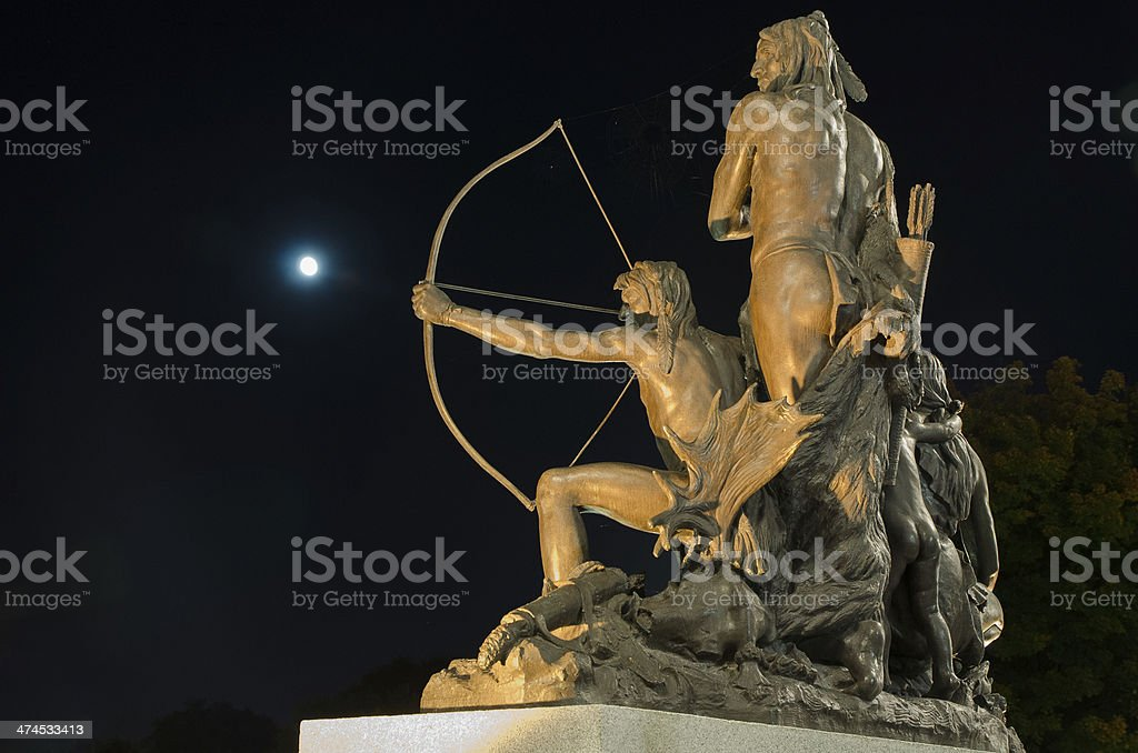 Indian (Native American) aiming at moon with his bow stock photo