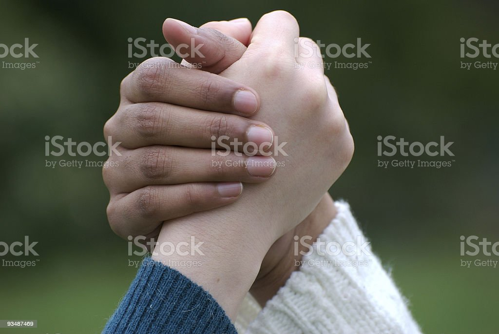Indian and Japanese women holding hands, teamwork concept royalty-free stock photo