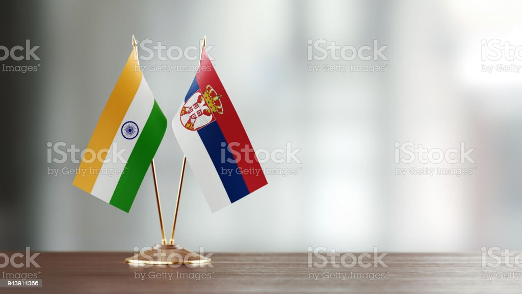Indian And Serbian Flag Pair On A Desk Over Defocused Background - fotografia de stock
